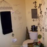 guest bath black writing on wall