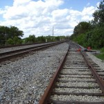 party and entertain railroad tracks blue sky white clouds